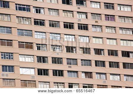 Closeup Hi-rise Apartment Complex With Brown Facade