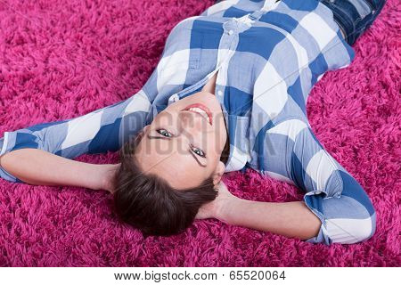 Woman Lying On A Pink Carpet