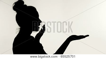 silhouette of a women showing something