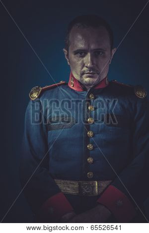 Chief, general of the Spanish army, blue coat and gold epaulettes