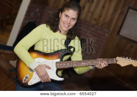 Woman Electric Guitar Player