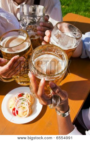 Group of four friends drinking beer