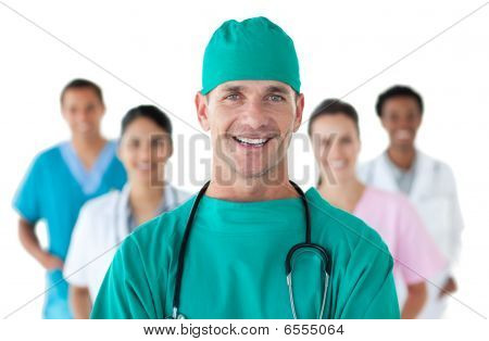 Smiling Surgeon In Front Of His Team