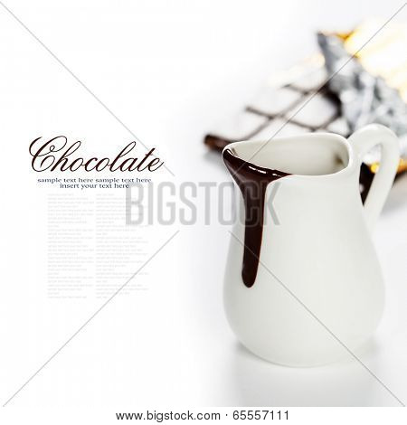 Delicious rich and thick chocolate sauce in a jug