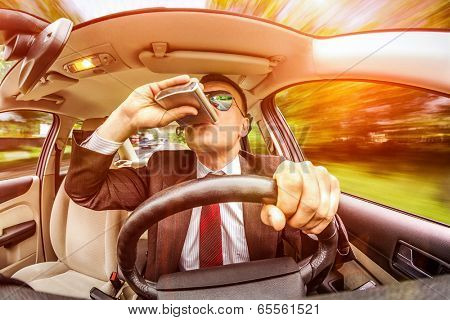 Drunk man in a suit and sunglasses driving on a road in the car vehicle.