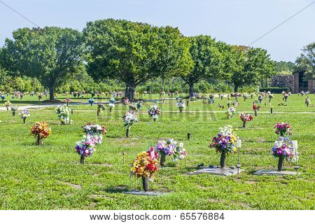 American Cemetery With Flowers At The Graves