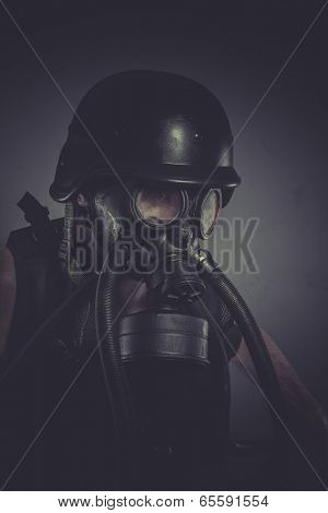 Toxins nuclear and toxicological disaster ,man with gas mask