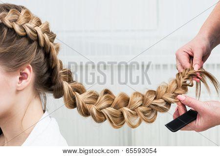 weave braid girl in a hair salon