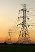 high voltage electric pole during nice sunset poster