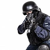 Special weapons and tactics SWAT team officer with his gun poster