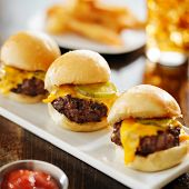 burger sliders with melted cheese and pickle poster