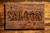 signboard of saloon on a wooden wall poster