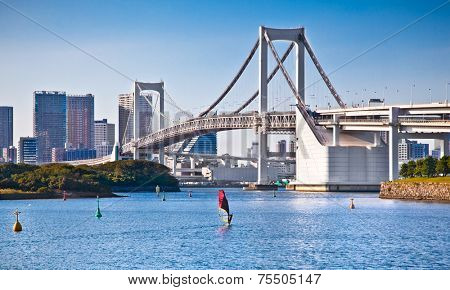 Rainbow Bridge and Sumida River in Tokyo, Japan. Day photo.