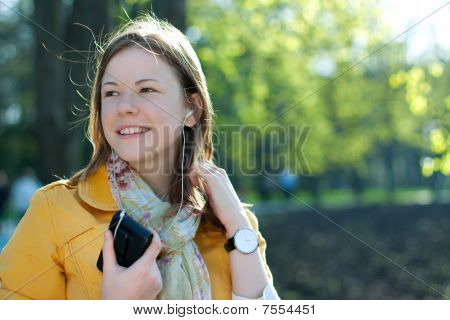 Young Woman Listnening Music