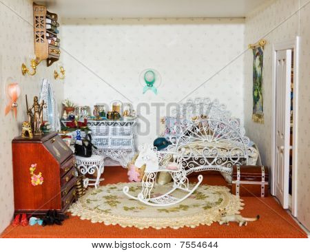 Dolls house with girl bedroom