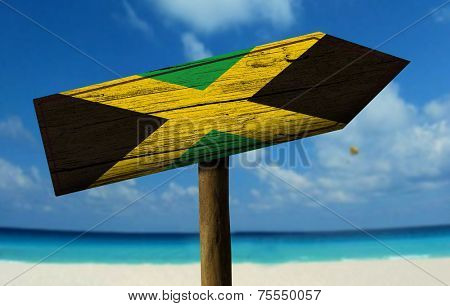 Jamaica wooden sign with a beach on background - Central America