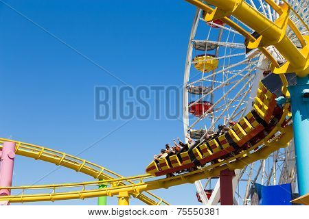 SANTA MONICA, USA - SEP 18: The amusement park on the Santa Monica Pier in Santa Monica, California on September 18, 2013. The pier is a more than hundred-year-old historic landmark.