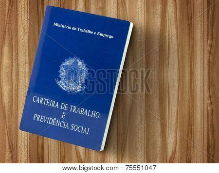 Brazilian document work and social security ( Carteira de Trabalho e Previdencia Social) on wood table