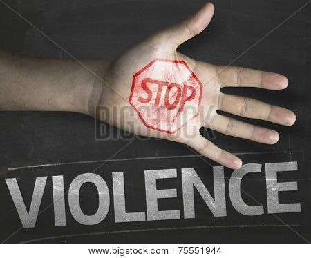 Educational and Creative composition with the message Stop Violence on the blackboard