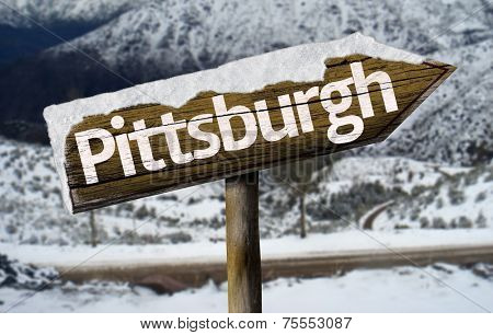 Pittsburg , USA , America wooden sign with a snow background