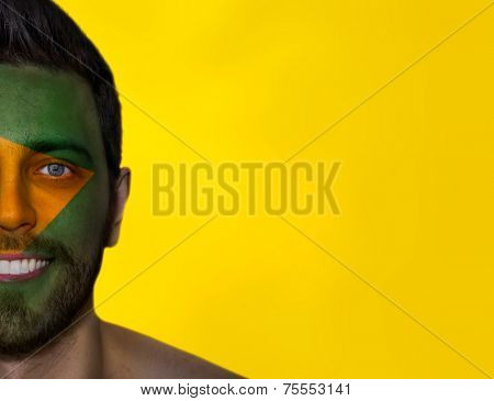 Portrait of a man painted the flag of Brazil - Latin America