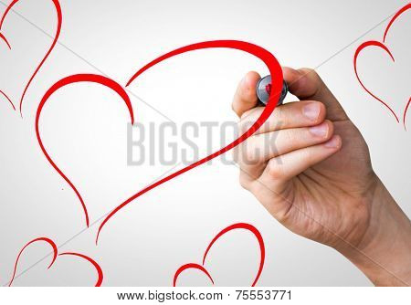 Hearts shape hand writing with a red mark on a transparent board