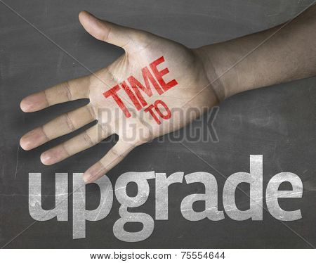 Educational and Creative composition with the message Time to Upgrade on the blackboard