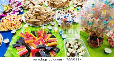 Colorful table with many delicious for the kids