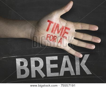 Educational and Creative composition with the message Time for a Break on the blackboard