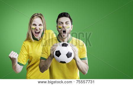 Brazilian fans celebrates on the green background