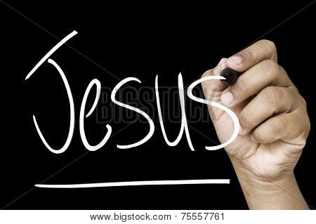 Jesus hand writing with a white mark on a transparent board
