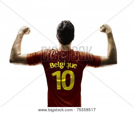 Belgian soccer player celebrates on white background