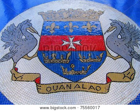 The coat of arms of Saint Barthelemy in mosaic.