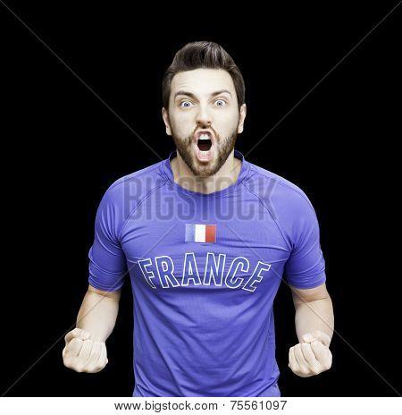French soccer player celebrates on black background