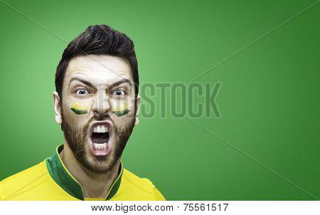 Brazilian fan celebrates on green background
