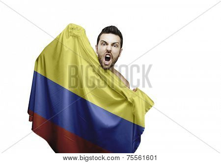 Fan holding the flag of Colombia celebrates on white background