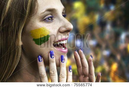 Blonde Brazilian fan celebrates in the stadium
