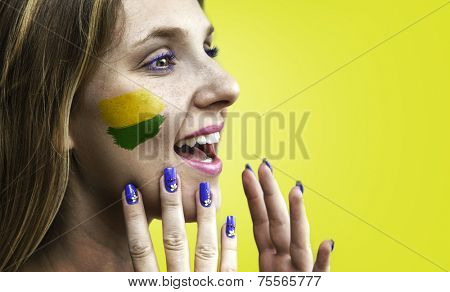 Blonde Brazilian fan celebrates on yellow background