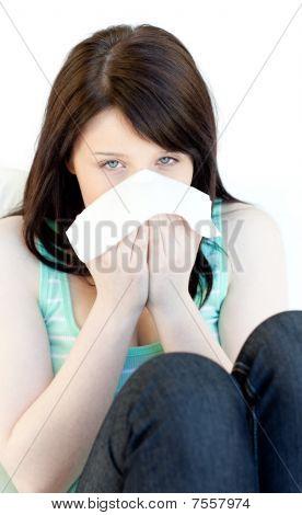 Sick Cute Woman Blowing Sitting On A Sofa