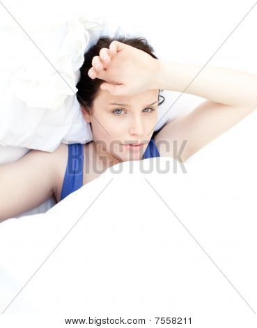 Tired Woman Relaxing In Her Bed