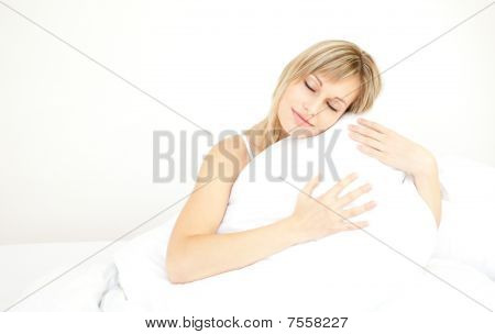 Beautiful Woman Hugging Her Pillow