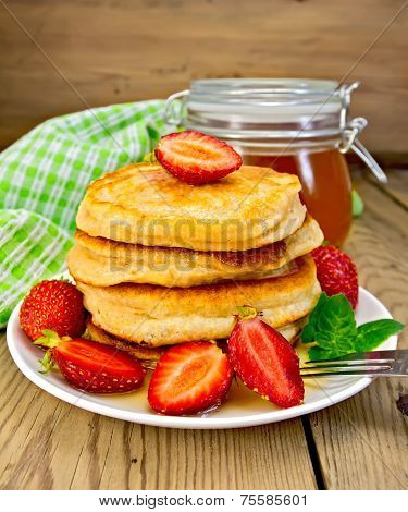 Flapjacks with strawberries and honey on board