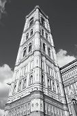Famous Giotto's Campanile - bell tower of Florence cathedral. Architecture in Italy. UNESCO World Heritage Site. Black and white tone - retro monochrome BW color style. poster