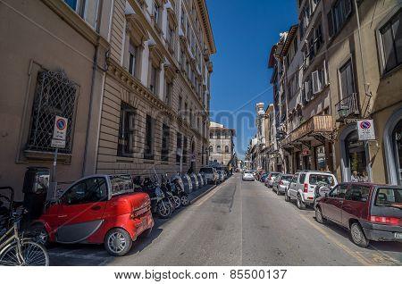 Small Red Electric Car On Street Borgo Ognissanti In Florence.