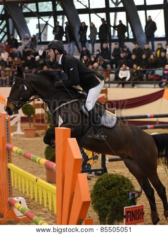 KAPOSVAR, HUNGARY - MARCH 15: Andrija Hrgovic jumps with his horse (Calysta) on the Masters Tournament International Jumping Competition, March 15, 2015 in Kaposvar, Hungary