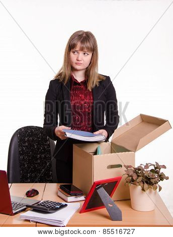 Dismissed Girl Collects His Belongings In A Box