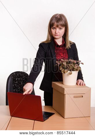 Dismissed Girl In Office Collects Things And Closes Laptop