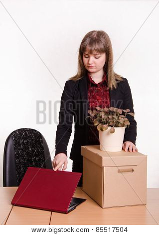 Dismissed Girl In Office With A Box And Flower Closes Laptop