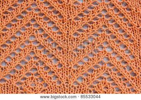 Openwork Pattern With Orange Thread On A Light Background
