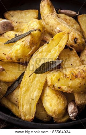Roast fingerling potatoes with sage, garlic and herbs.